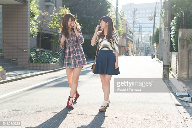 Japanese women walking on street,smiling