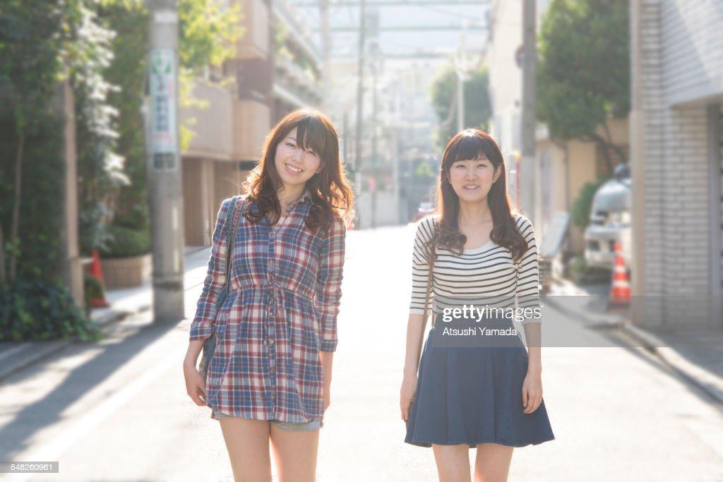 Japanese women walking on street,smiling : Stock Photo