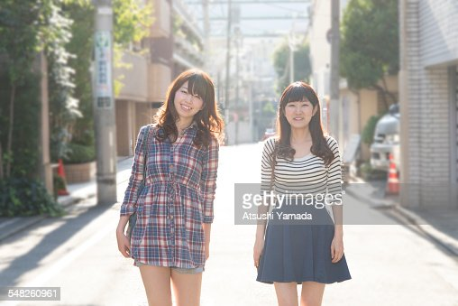 Japanese women walking on street,smiling : Stock Photo