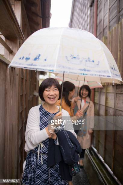 Japanese women walking together in narrow path