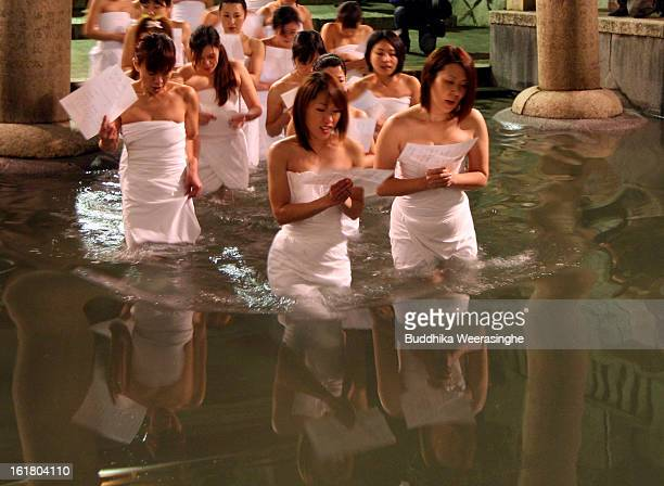 Japanese women wear pray as enter freezing cold water pond during Naked Festival on February 16 2013 in Okayama Japan Saidaiji Naked Festival is one...