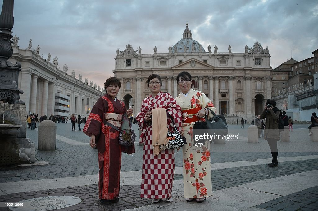 Japanese women wearing traditional kimonos pose in front of St Peter's basilica on the eve of the conclave on March 11, 2013 at the Vatican. Catholic cardinals had a final day of jockeying for position the same day before shutting themselves into the Sistine Chapel to elect a new pope after Benedict XVI's shock resignation, with an Italian and a Brazilian who both head powerful archdioceses among the top contenders.