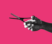 Man hand holding a Scissors on Colorful background