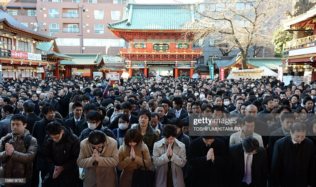 Japanese worshippers gather at the Kanda shrine to pray for a good business year in Tokyo on January 4, 2013, on the first business day after the new year holidays. Tokyo stocks jumped more than three percent on January 4, the first day of 2013 trading, following global rallies on a US deal to avert a 'fiscal cliff' of tax hikes and huge spending cuts.
