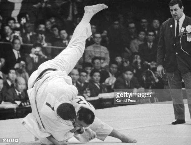 Japanese wrestler Isao Inokuma beats Canada's Alfred Douglas Rogers in the Judo Heavyweight final at the Tokyo Olympics 1964