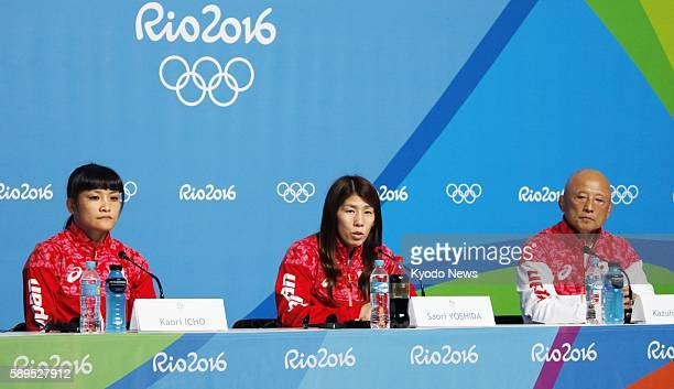 Japanese wrestlers Saori Yoshida and Kaori Icho hold a press conference together with national team director Kazuhito Sakae on Aug 14 before the...