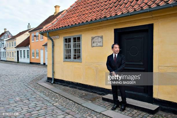 Japanese writer Haruki Murakami is pictured outside Hans Christian Andersen's house in Odense on October 30 2016 Murakami is visiting Odense where he...