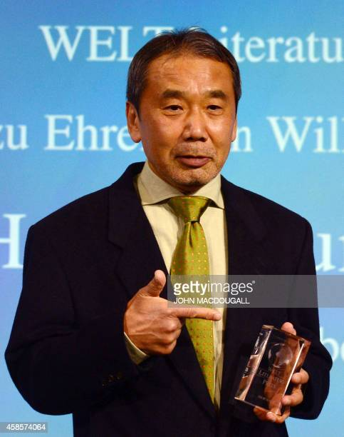 Japanese writer Haruki Murakami poses with his trophy prior to an award ceremony for the Germany's Welt Literature Prize bestowed by the German daily...