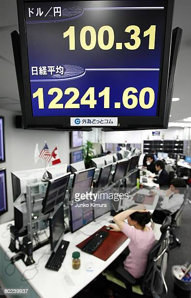Japanese yen against US dollars and Nikkei Stock Average are displayed on the electric board at a Gaitamecom a foreign exchange trading company on...