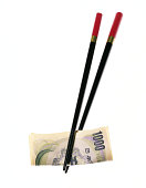 Japanese yen and chopsticks