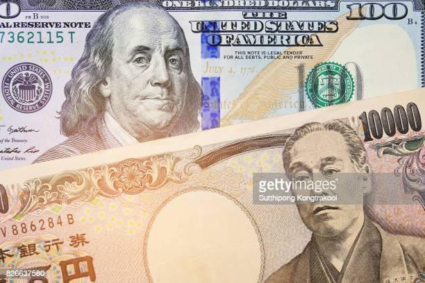 Japanese Yen and USD Dollar Bank note pile, Business and finance concept. 10,000 Japanese Yen and 100 dollar BankNote. Money background.currency exchange rate