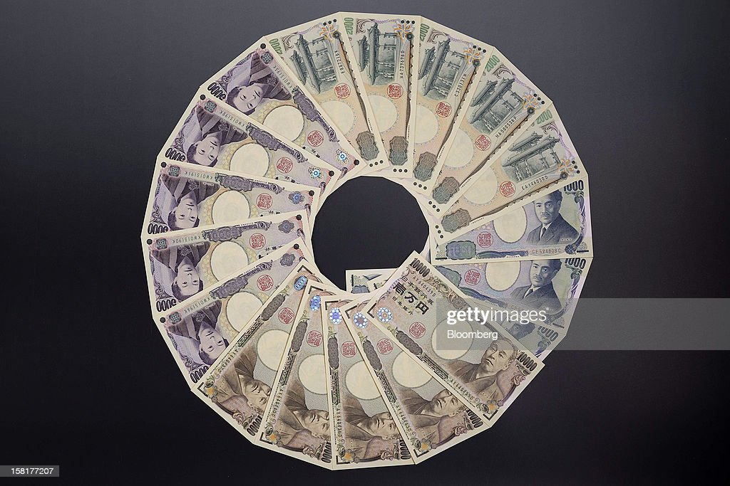 Japanese yen banknotes of various denominations are arranged for a photograph in Kawasaki, Kanagawa Prefecture, Japan, on Monday, Dec. 10, 2012. The yen is losing its status as a haven for risk-averse investors as Japan lurches toward a chronic trade deficit and the front-runner to become the next prime minister calls for unlimited central-bank stimulus. Photographer: Akio Kon/Bloomberg via Getty Images