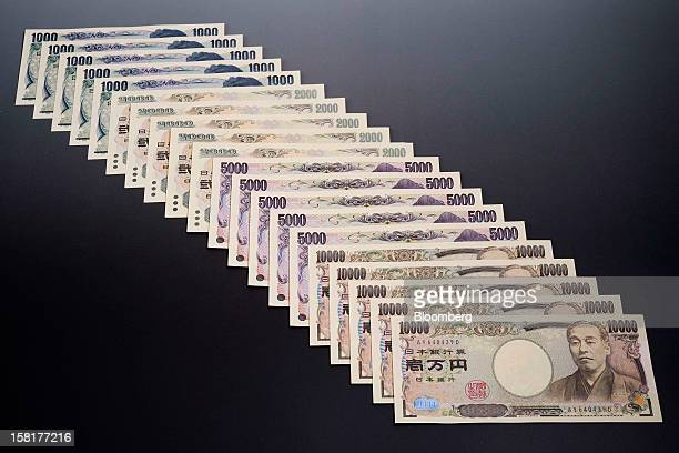 Japanese yen banknotes of various denominations are arranged for a photograph in Kawasaki Kanagawa Prefecture Japan on Monday Dec 10 2012 The yen is...