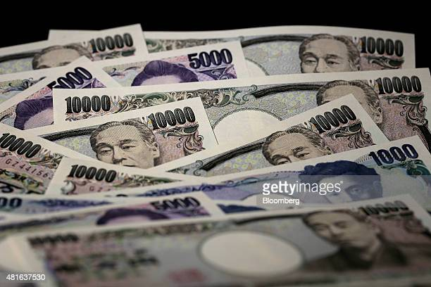 Japanese yen banknotes of various denominations are arranged for a photograph in Tokyo Japan on Wednesday July 22 2015 The yen slipped 01 percent to...