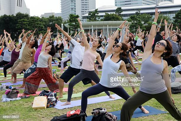 Japanese yoga students participate in an outdoor yoga class at a park in Yokohama suburban on September 21 2015 Hundreds of participants took part in...