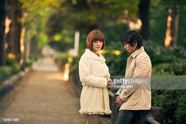 japanese young couple breaking out