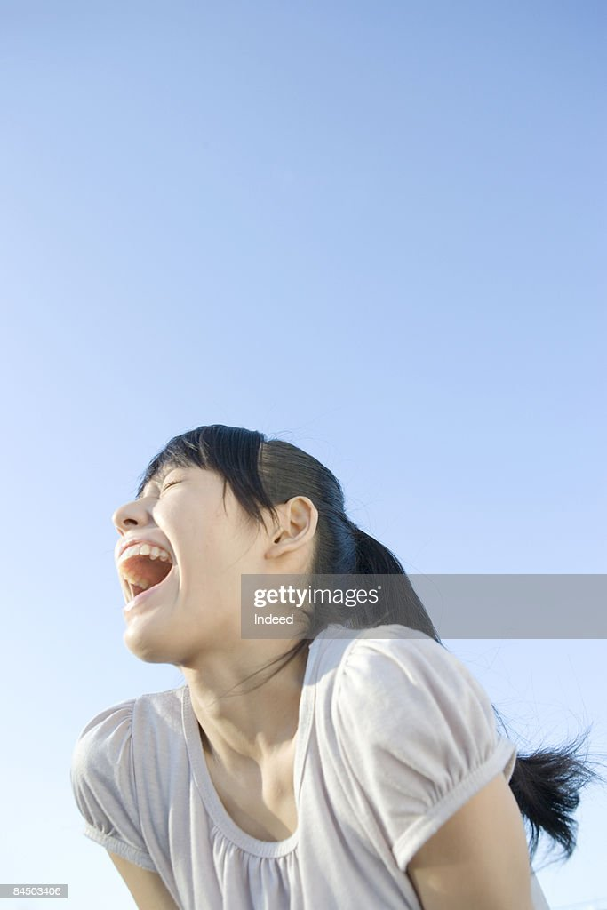 Japanese young woman shouting
