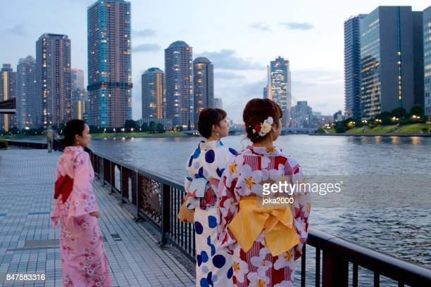 Japanese young women in Yukata watching something