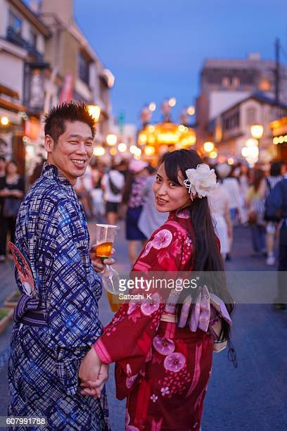 Japanese Yukata couple walking on festive street
