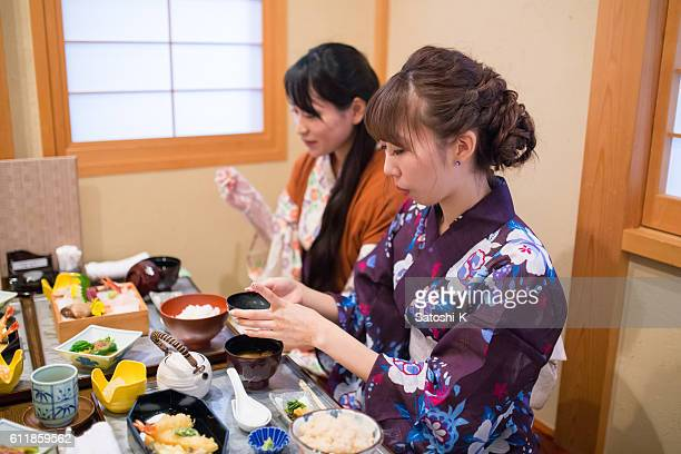 Japanese Yukata girls having lunch at Japanese restaurant