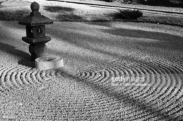 Japanese Zen Rock Garden with Ornamental Statue