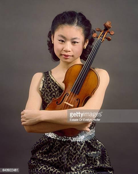 Japaneseborn American violinist Midori Goto or Midori New York 1989