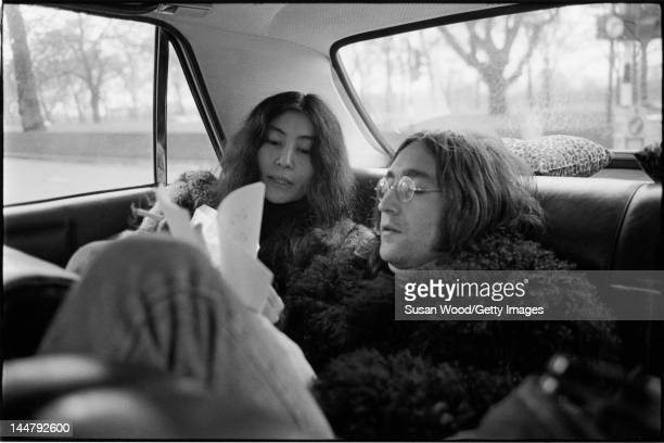 Japaneseborn artist and musician Yoko Ono and British musican and artist John Lennon ride together in the backseat of a car December 1968