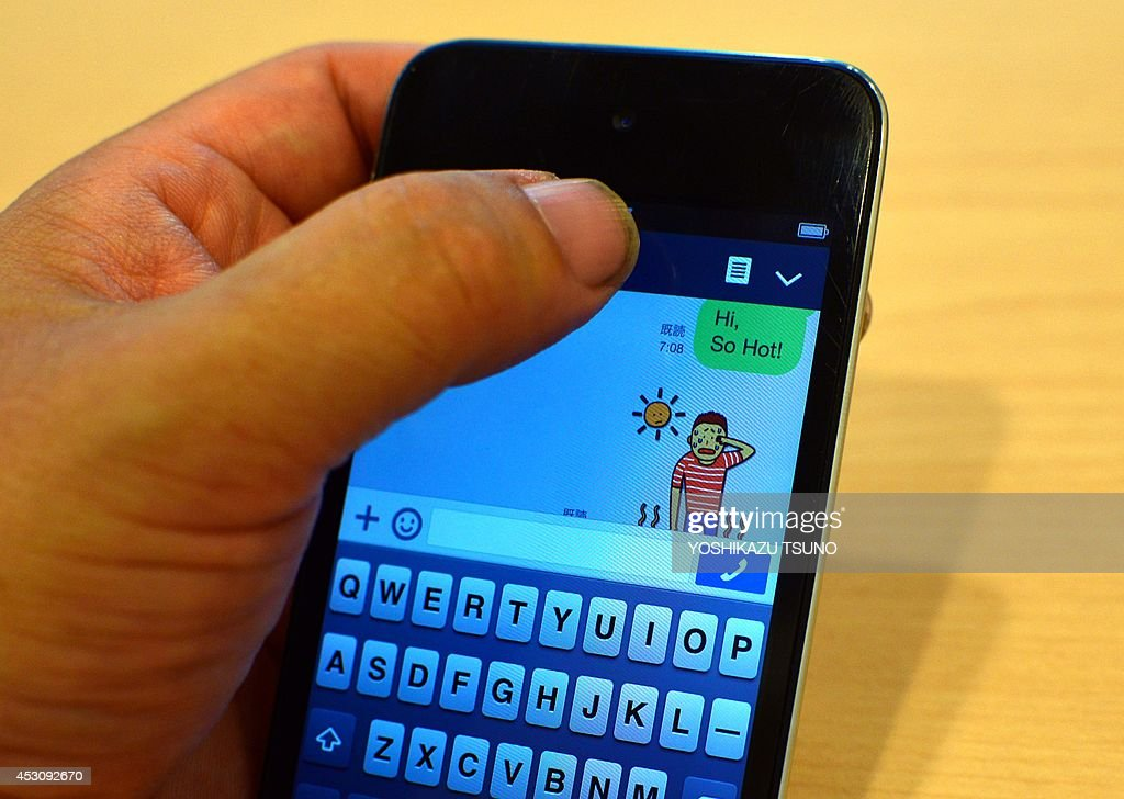 STORY 'Japan-Line-US-IT-telecom-smartphones,FOCUS' BY A man uses a sticky service of Japan's smartphone based social networking service (SNS) 'Line' in Tokyo on August 3, 2014. A messaging app launched in the aftermath of Japan's 2011 earthquake and tsunami, Line is moving towards a possible dual listing in Tokyo and New York as it jostles for space in an increasingly crowded and imaginative market. AFP PHOTO / Yoshikazu TSUNO