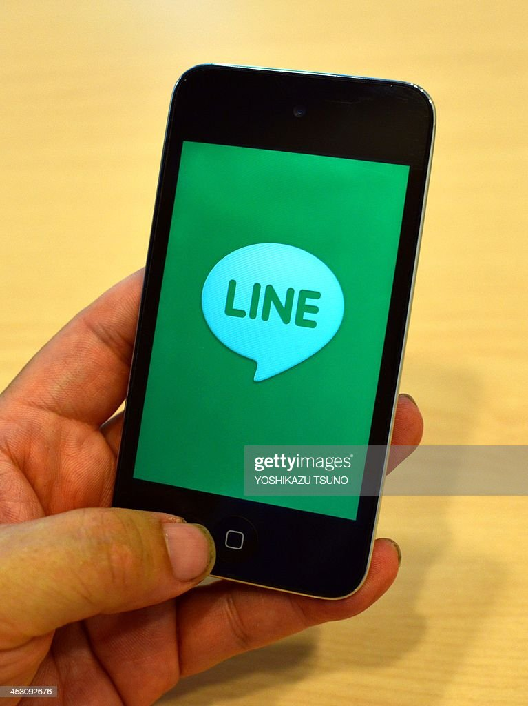 STORY 'Japan-Line-US-IT-telecom-smartphones,FOCUS' BY A man uses Japan's smartphone based social networking service (SNS) 'LINE' in Tokyo on August 3, 2014. A messaging app launched in the aftermath of Japan's 2011 earthquake and tsunami, Line is moving towards a possible dual listing in Tokyo and New York as it jostles for space in an increasingly crowded and imaginative market. AFP PHOTO / Yoshikazu TSUNO