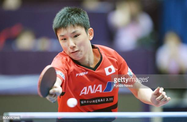 Japan's 13yearold Tomokazu Harimoto plays against Germany's Timo Boll in the semifinals of the China Open in Chengdu China on June 24 2017 Boll the...