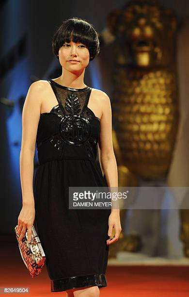 Japan's actress Rinko Kikuchi poses before the screening of the movie 'The Sky crawlers' directed by Japan's Mamoru Oshii at the 65th Venice...