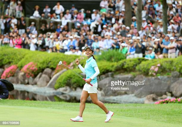 Japan's Ai Miyazato celebrates after making a par putt on the 18th green in the final round of the Suntory Ladies Open golf tournament at Rokko...