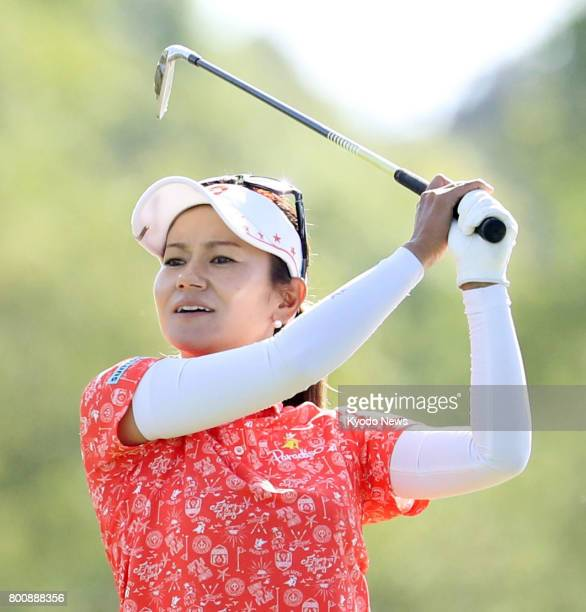 Japan's Ai Miyazato hits her second shot on the fourth hole during the final round of the Walmart NW Arkansas Championship at the Pinnacle Country...