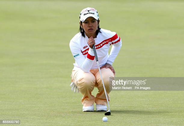 Japan's Ai Miyazato lines up a put on the 18th green during the Ricoh Women's British Open at The Old Course St Andrews Scotland