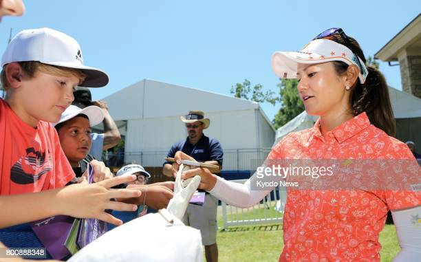Japan's Ai Miyazato signs autographs for fans after finishing in a tie for 66th with a total score of 2under 211 at the Walmart NW Arkansas...