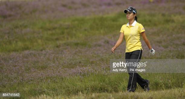Japan's Ai Miyazato walks through the heather on the 5th hole during Round Three of the Ricoh Women's British Open at Sunningdale Golf Club Berkshire