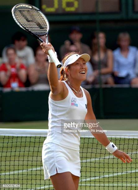 Japan's Ai Sugiyama celebrates her win over Switzerland's Martina Hingis during the third round of The All England Lawn Tennis Championships at...