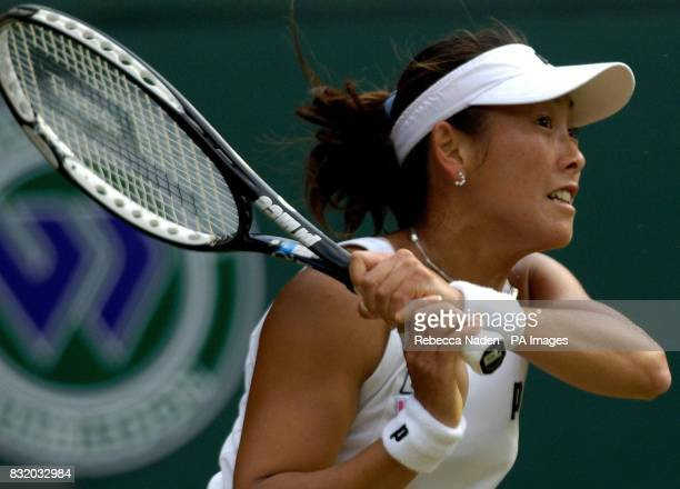 Japan's Ai Sugiyama in action against Switzerland's Martina Hingis during the third round of The All England Lawn Tennis Championships at Wimbledon
