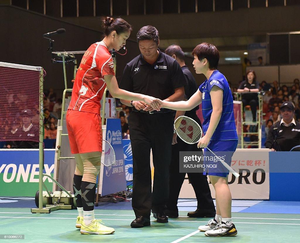 Japan s Akane Yamaguchi R and China s Sun Yu L shake hands