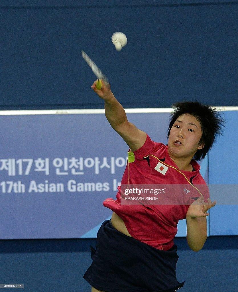 Japan s Akane Yamaguchi hits a return against Malaysia s Jing Yi