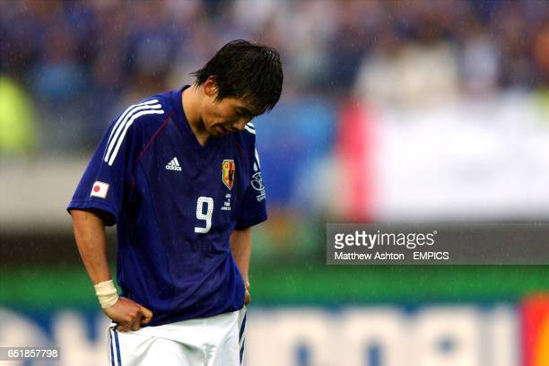 Japan's Akinori Nishizawa hangs his head after losing to Turkey