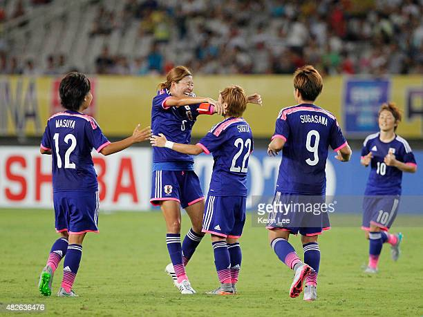 Japan's Ami Sugita celebrates after she scored a goal during a game against DPR Korea at EAFF Women's East Asian Cup 2015 final round on August 1...