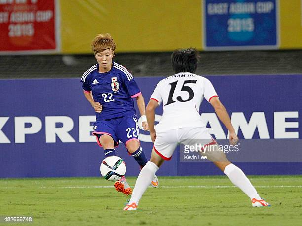 Japan's Ami Sugita in action against players of DPR Korea during EAFF Women's East Asian Cup 2015 on August 1 2015 in Wuhan China