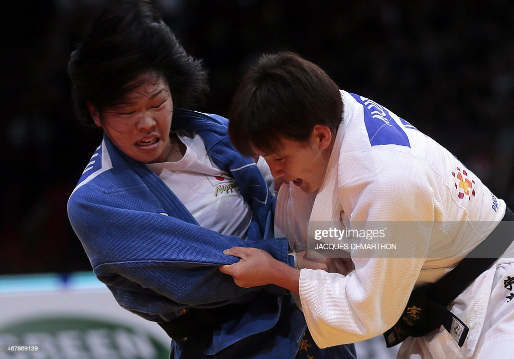 Japan's Anzu Yamamoto competes against Japan's Nae Udaka during the under 57kg finals at the2014 Paris Judo Grand Slam tournament on February 8 2014...