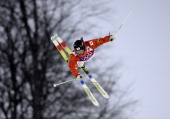 Japan's Arisa Murata competes in the Women's Freestyle Skiing Moguls qualifications at the Rosa Khutor Extreme Park during the Sochi Winter Olympics...