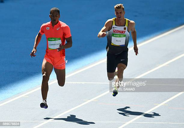 Japan's Aska Cambridge and Germany's Julian Reuss compete in the Men's 100m Round 1 during the athletics event at the Rio 2016 Olympic Games at the...