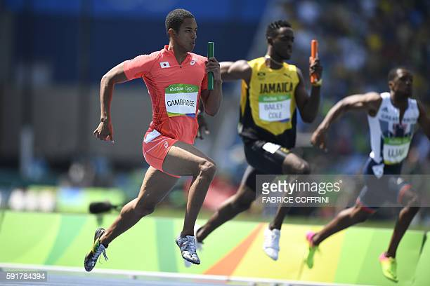 Japan's Aska Cambridge competes in the Men's 4 x 100m Relay Round 1 during the athletics event at the Rio 2016 Olympic Games at the Olympic Stadium...