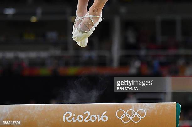 TOPSHOT Japan's Asuka Teramoto competes in the beam event of the women's individual allaround final of the Artistic Gymnastics at the Olympic Arena...