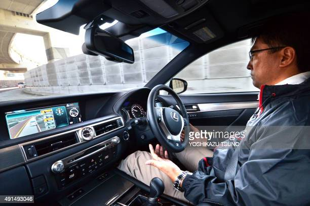 Japan's auto giant Toyota demonstrates autonomous driving with a Lexus GS450h on the Tokyo metropolitan highway during Toyota's advanced technology...