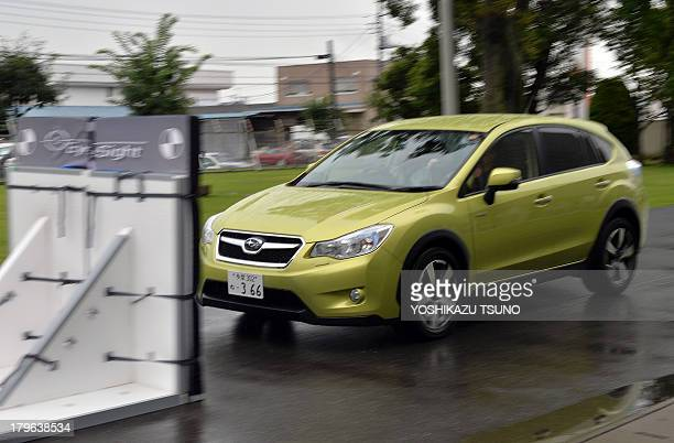 Japan's auto maker Fuji Heavy Industries known as Subaru brand demonstrates the precrash technology 'EyeSight' using Subaru's latest vehicle 'XV...